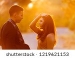 young couple exchanging...   Shutterstock . vector #1219621153