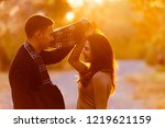 young couple exchanging...   Shutterstock . vector #1219621159