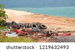garbage on tropical beach. old... | Shutterstock . vector #1219632493