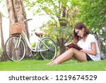 young woman reading a book in... | Shutterstock . vector #1219674529