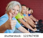 smiling senior woman holding... | Shutterstock . vector #121967458