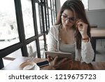 concentrated business woman... | Shutterstock . vector #1219675723