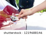 close up of hand opening car... | Shutterstock . vector #1219688146