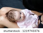 baby girl two months old... | Shutterstock . vector #1219743376