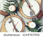 festive table setting among... | Shutterstock . vector #1219767553