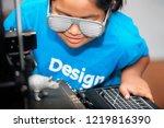 a smart young girl of mixed... | Shutterstock . vector #1219816390