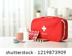 first aid kit with pills on... | Shutterstock . vector #1219873909