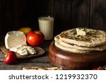 pita bread on wooden board with ... | Shutterstock . vector #1219932370