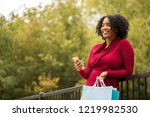 woman shopping and texting.   Shutterstock . vector #1219982530