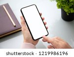 female hand holding touch phone ... | Shutterstock . vector #1219986196