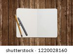 open book with blank pages on... | Shutterstock . vector #1220028160