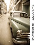 an old automobile in the center ...   Shutterstock . vector #122004748