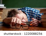 a tired and tortured disheveled ... | Shutterstock . vector #1220088256