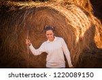 Girl Farmer On A Haystack Round ...