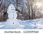 Snow Man In Winter Forest...