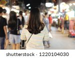 young asian woman traveler with ... | Shutterstock . vector #1220104030