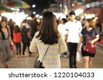 young asian woman traveler with ... | Shutterstock . vector #1220104033