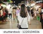 young asian woman traveler with ... | Shutterstock . vector #1220104036