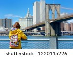 happy young woman tourist... | Shutterstock . vector #1220115226