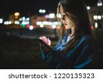 woman using smart phone mobile... | Shutterstock . vector #1220135323