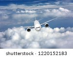 passenger airplane flying on a... | Shutterstock . vector #1220152183