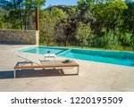 sun lounge by the pool | Shutterstock . vector #1220195509