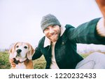 man takes selfie photo with his ... | Shutterstock . vector #1220232433