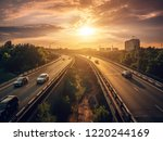 urban traffic cars drive at... | Shutterstock . vector #1220244169