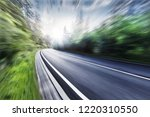 the highway is in green forest. | Shutterstock . vector #1220310550