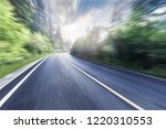 the highway is in green forest. | Shutterstock . vector #1220310553