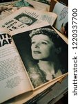 Small photo of Paris, FRANCE - NOVEMBER 25, 2014: Edith Piaf in an old magazine at La Galcante, the most unique bookshop in Paris