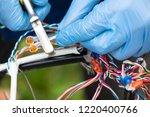 fiber optic  technicians are...   Shutterstock . vector #1220400766