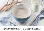 fresh yogurt on white table...   Shutterstock . vector #1220453380