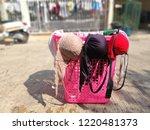 drying brassiere on pink basket ... | Shutterstock . vector #1220481373