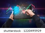 hand touching tablet with...   Shutterstock . vector #1220495929