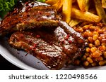 tasty grilled ribs with french... | Shutterstock . vector #1220498566