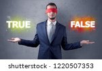 businessman with red ribbon on... | Shutterstock . vector #1220507353