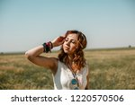 young girl wearing a white... | Shutterstock . vector #1220570506