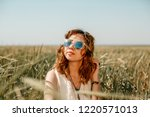 young girl wearing a white... | Shutterstock . vector #1220571013