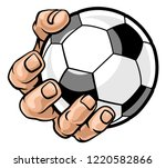 A Strong Hand Holding A Soccer...