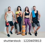 group of four athletic young... | Shutterstock . vector #1220605813