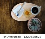 hot fresh coffee cup with wood... | Shutterstock . vector #1220625529