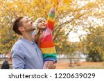 father and his cute daughter... | Shutterstock . vector #1220639029
