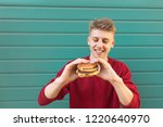 hungry man with food in his... | Shutterstock . vector #1220640970