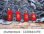 four red advent candles with... | Shutterstock . vector #1220661193