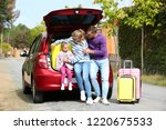 young family with suitcases... | Shutterstock . vector #1220675533