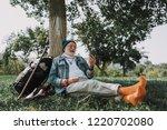 full length portrait of smiling ... | Shutterstock . vector #1220702080