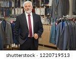 old elegant man in grey costume ...   Shutterstock . vector #1220719513