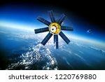 space satellite orbiting the... | Shutterstock . vector #1220769880