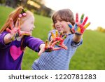 two young cheerful children...   Shutterstock . vector #1220781283